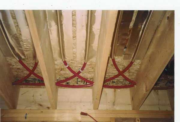 The floor joist installation diy radiant floor heating for Wood floor joist spacing